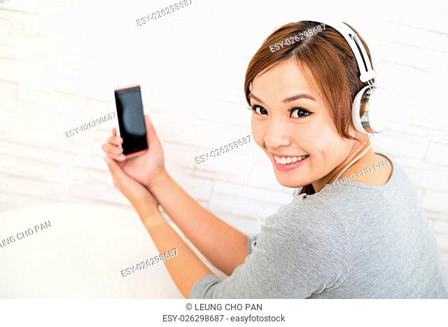 Woman listen to music with headphone