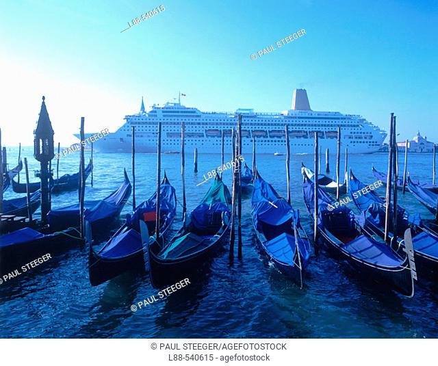 Gondolas and cruise ship, Venice. Veneto, Italy