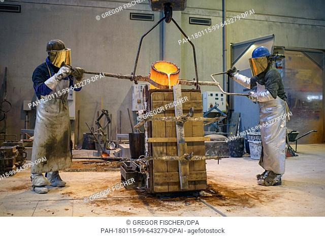 """Employees of the synthetic cast manufactury """"""""Hermann Noack"""""""" fill hot lead into the sand casts of Berlinale bear trophies in Berlin, Germany, 15 January 2018"""