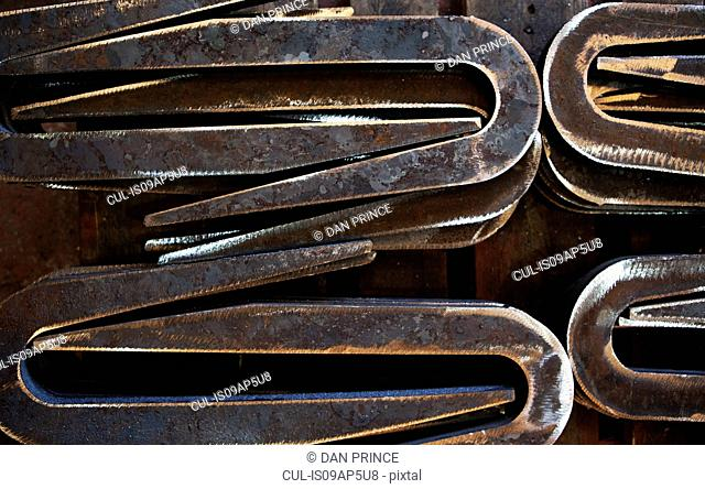 Close-up of metal shapes in factory