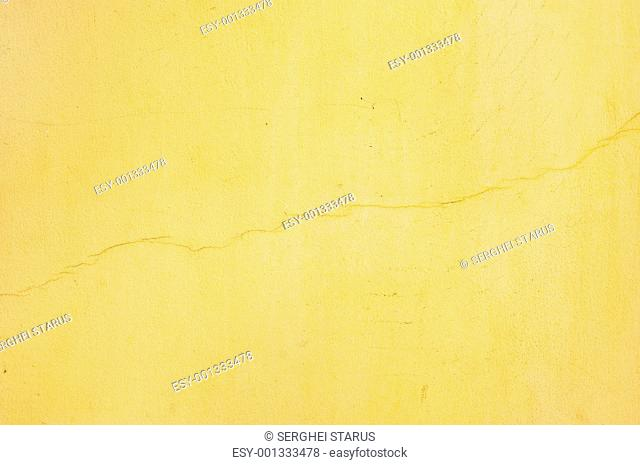 yellow stucco with crack