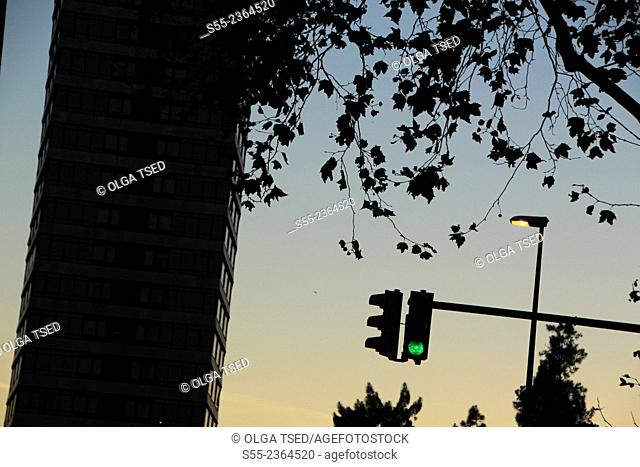 Street lamp and traffic light in the sunset. Barcelona, Catalonia, Spain