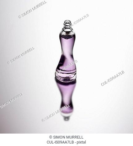 Bottle of perfume with reflection
