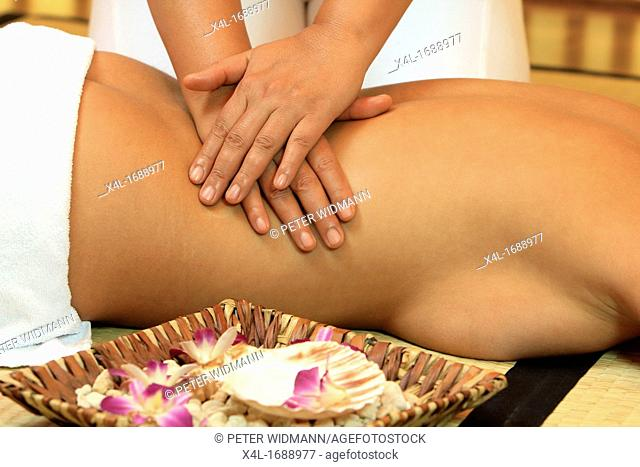 Young woman relaxing with a thai massage
