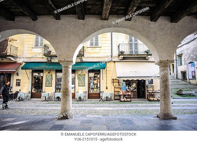 Portico of the palace of the community in Piazza Motta, village of Orta, Lake Orta, Piedmont, Italy