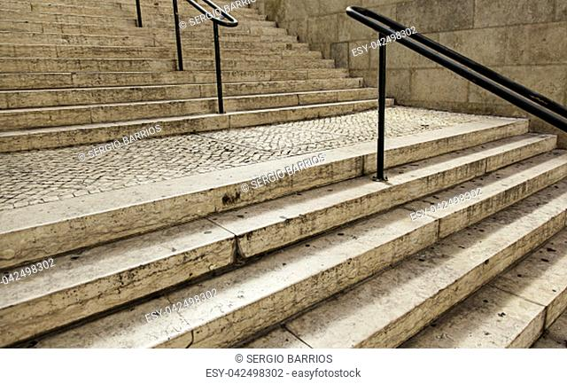 Typical stairs of lisbon in portugal, detail of old stone stairs for pedestrians