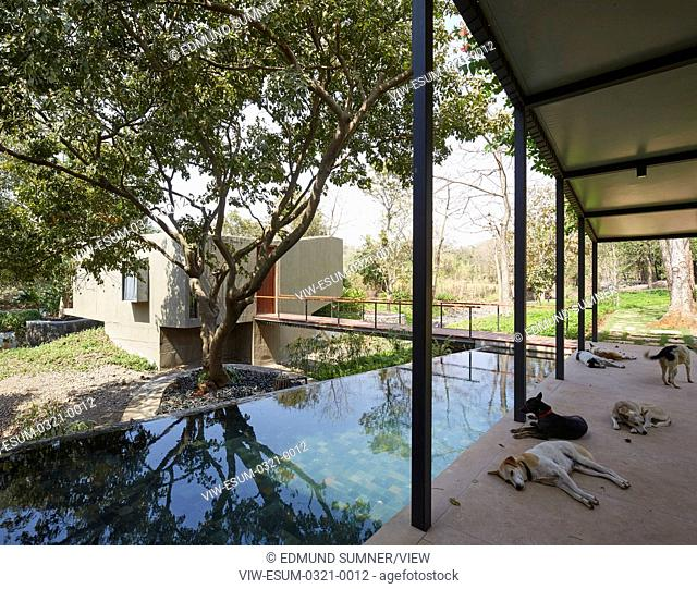 With a stream running through the house, this retreat in Alibag is delicately woven into the landscape, alternately opening up a
