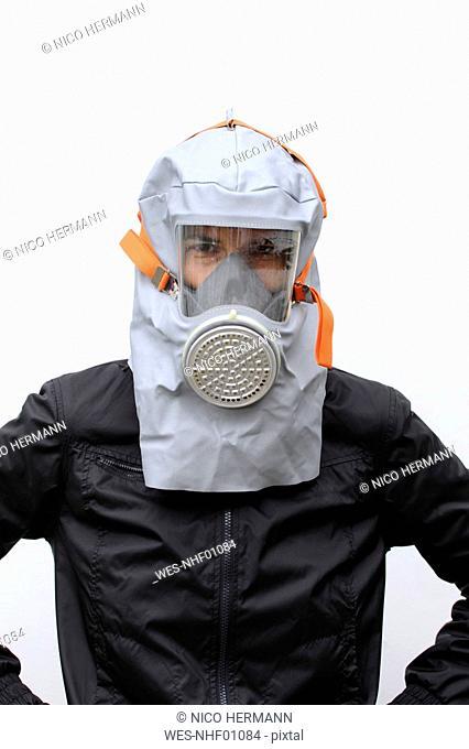 Woman wearing gas mask, portrait