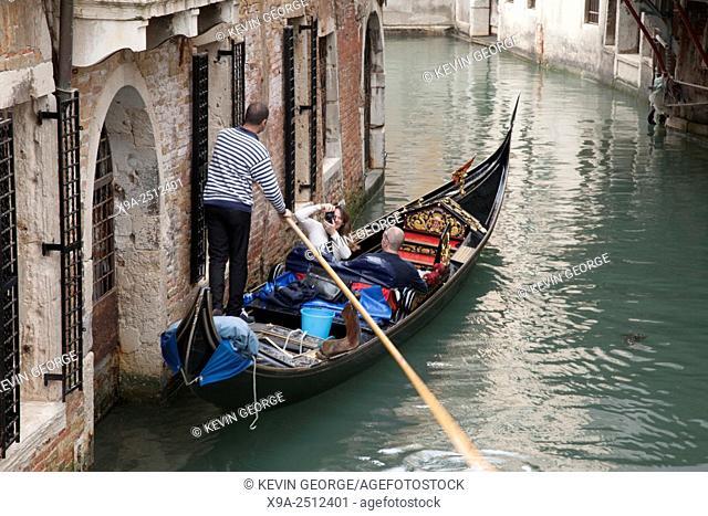 Gondola Trip on Venetian Canal; Venice; Italy