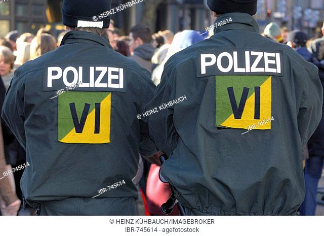 Two riot police officers from behind at a protest against the 2008 Munich Conference on Security Policy, Munich, Bavaria, Germany