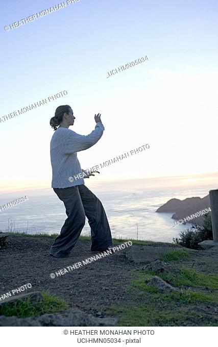 Woman practising yoga outdoors
