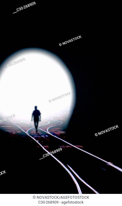 Man walking out of railroad tunnel