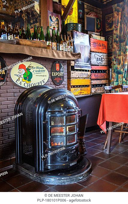 Old coal stove in tavern Kroegske, Belgian café-restaurant in the village Emelgem, Izegem, West Flanders, Belgium