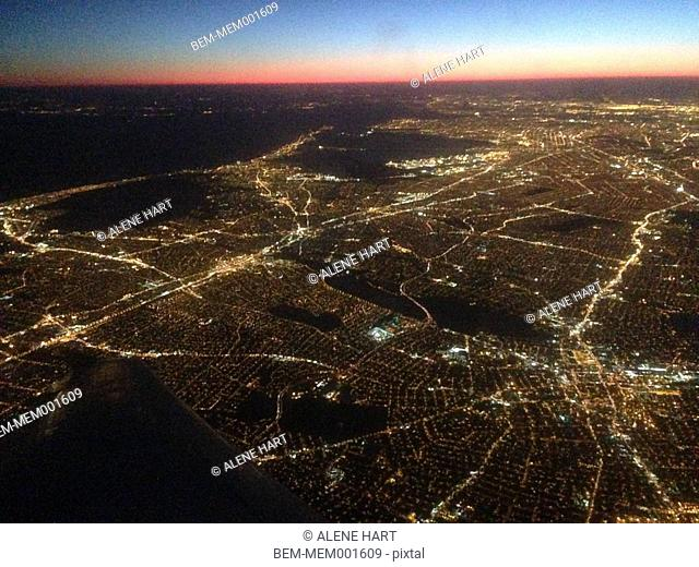 Aerial view of Chicago cityscape illuminated at night, Illinois, United States