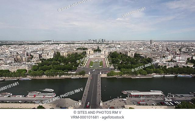 Locked down Shot, LS, HA, Daylight. The Jena Bridge Pont d'Iena and the Trocadero Gardens enclosed by the pavilions of the Palais de Chaillot