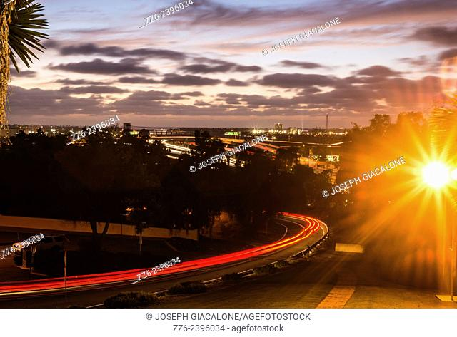 View looking west of roads and highways at night in San Diego, California, United States