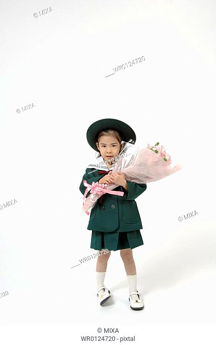 Girl holding a bouquet of pink carnation