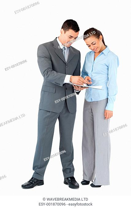Business partner working on a deal together against a white background