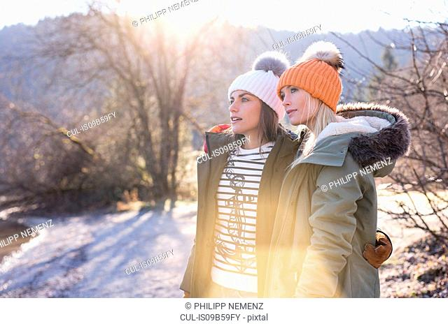 Two women looking out from lakeside in Bavarian Alps
