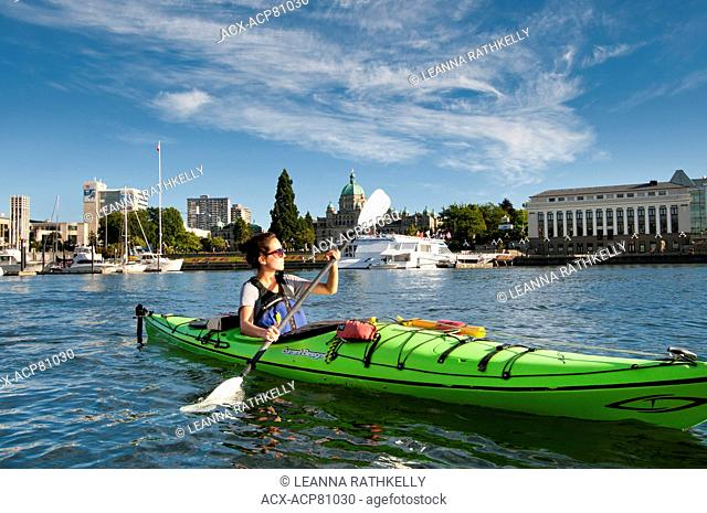 View from a kayak as we paddle the Inner Harbour of Victoria, BC, on a summer afternoon