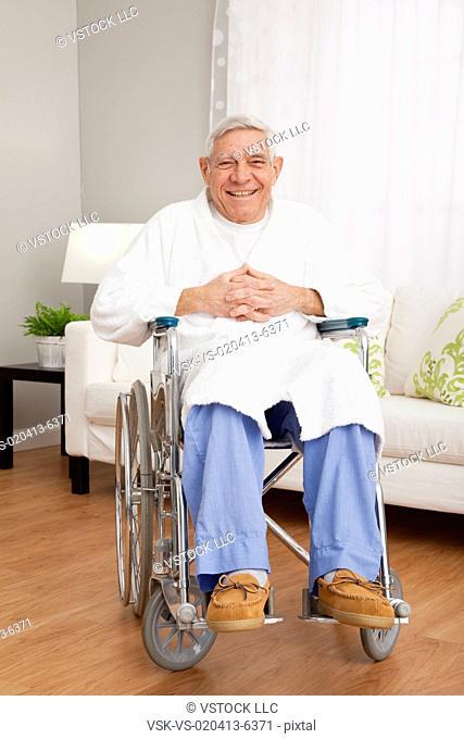 Portrait of smiling senior man on wheelchair