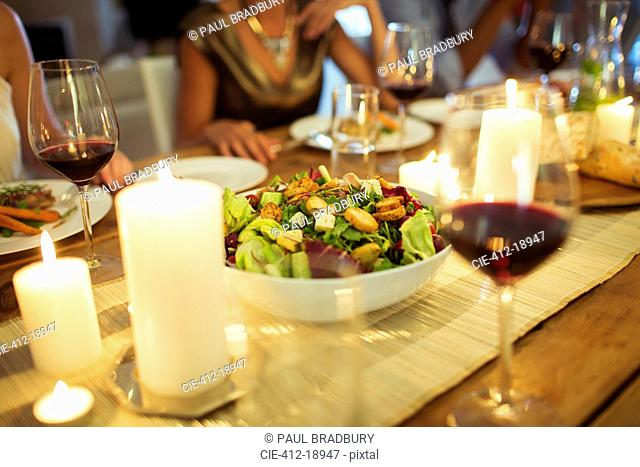 Salad bowl on table at dinner party