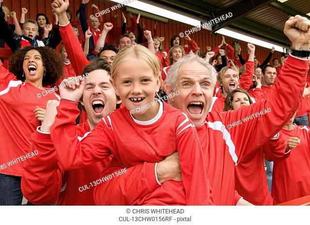 Fans celebrating at football match