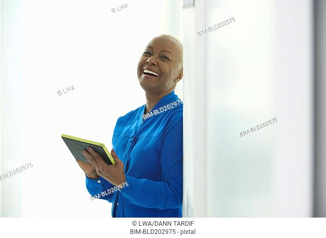 Black businesswoman taking notes