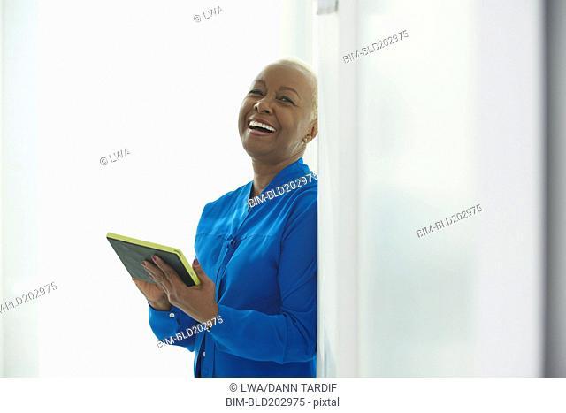 Black businesswoman taking notes