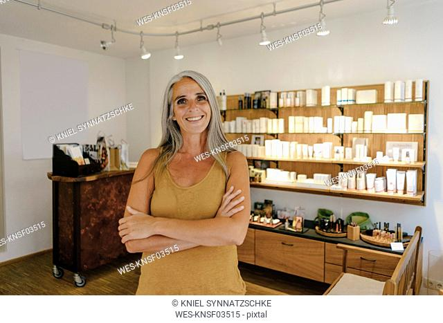 Portrait of smiling businesswoman in her shop