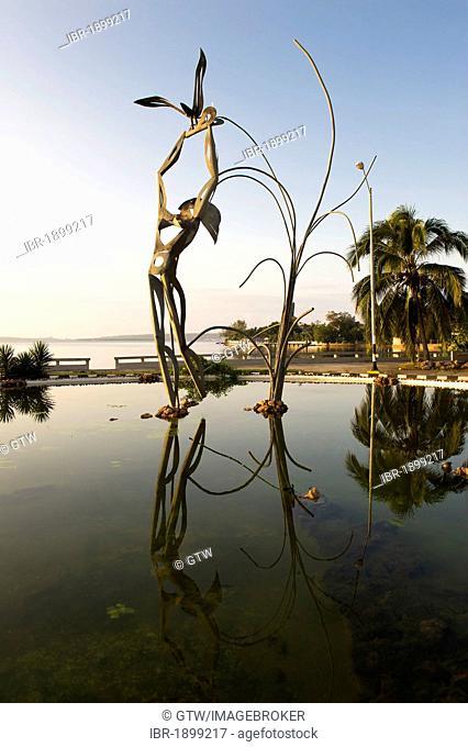Modern statue reflecting in water, Cienfuegos, Cuba