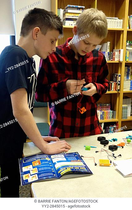 7th Grade Boys Working With Circuits, Wellsville, New York, USA