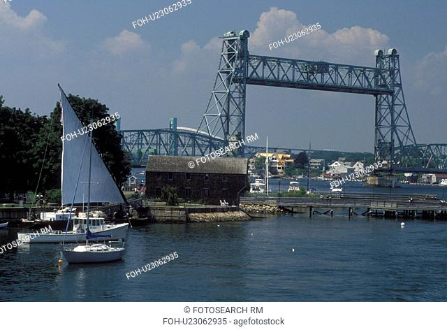 Portsmouth, NH, New Hampshire, Boats docked along the Piscataqua River in Portsmouth. View of Memorial Bridge crossing the Piscataqua River