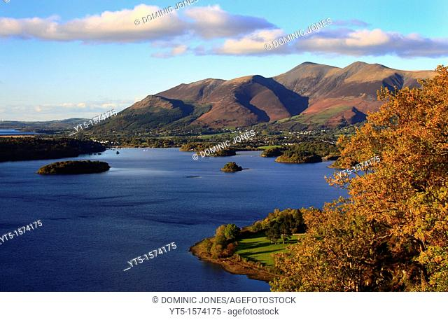 Evening light shines across Derwentwater onto the lofty peaks of the Skiddaw range, Lake District, Cumbria, England, Europe