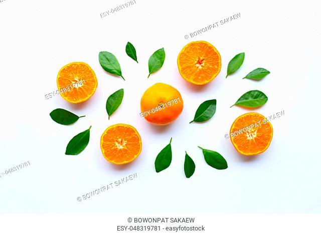 Fresh orange citrus fruit with green leaves on white background