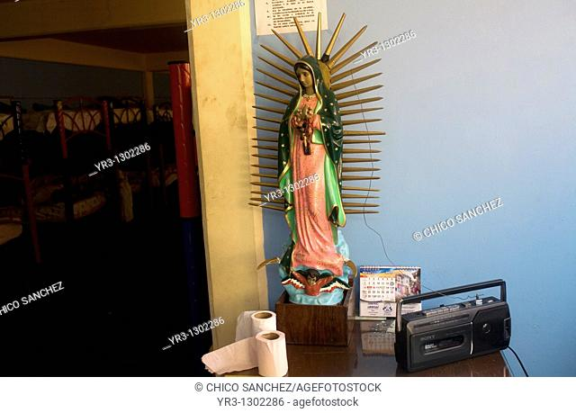 An image of the Our Lady of Guadalupe virgin decorates a shelter for migrants located along the railroad in Mexico City, Mexico, March 7, 2010