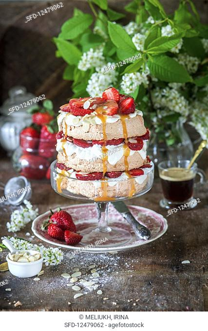 Brown sugar cake with meringue and strawberry
