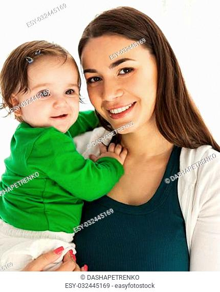 Happy smiling mother with eight months old baby