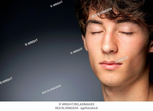 Teenager male boy portrait eyes closed close up