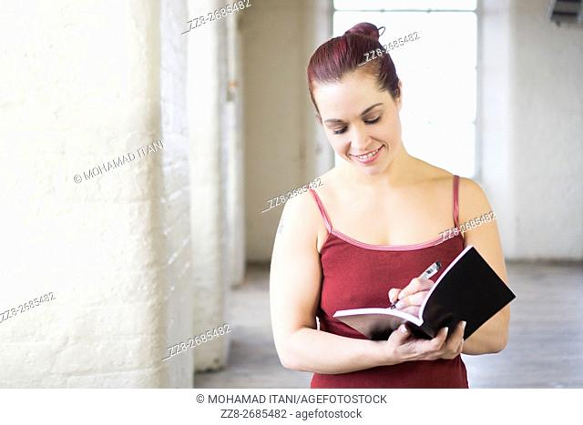 Woman writing on a book