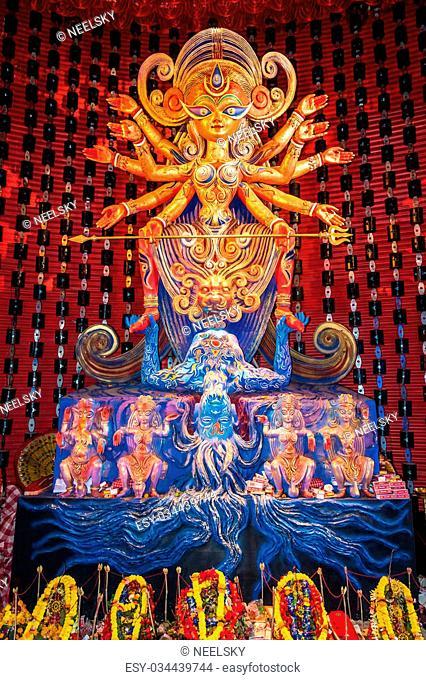 KOLKATA, INDIA - OCTOBER 23, 2015: Beautiful dazzling Durga idol at Durga Puja festival in Kolkata, West Bengal, India. Durga Puja is the biggest religious...