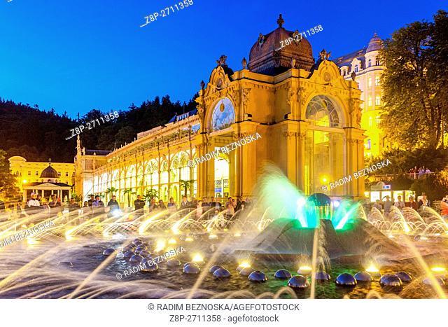 Evening lights Singing Fountain and the Colonnade, Marianske Lazne (Marienbad), a spa town, West Bohemia, Czech Republic