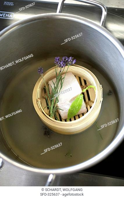 Cod with bay leaf & lavender in bamboo basket with liquid
