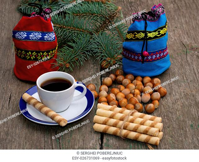 blue and red gift bag, coffee, forest nutlets, linking of cookies and fir-tree branch, subject holidays Christmas and New Year