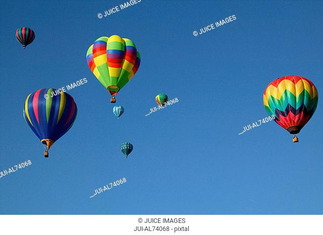 Low angle view of hot air balloons against blue sky, Balloon Festival, Albuquerque, New Mexico, USA