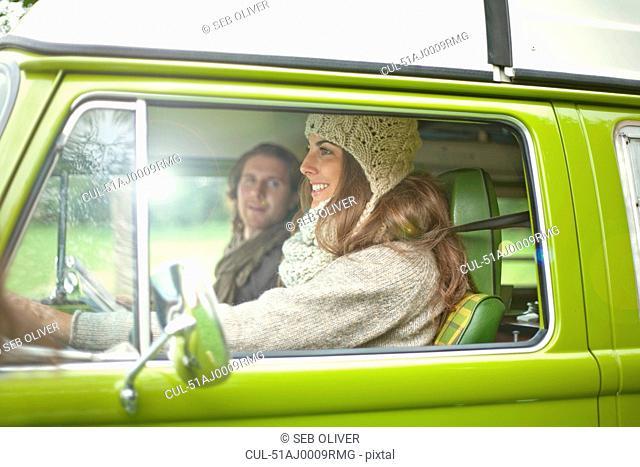 Woman driving boyfriend in van
