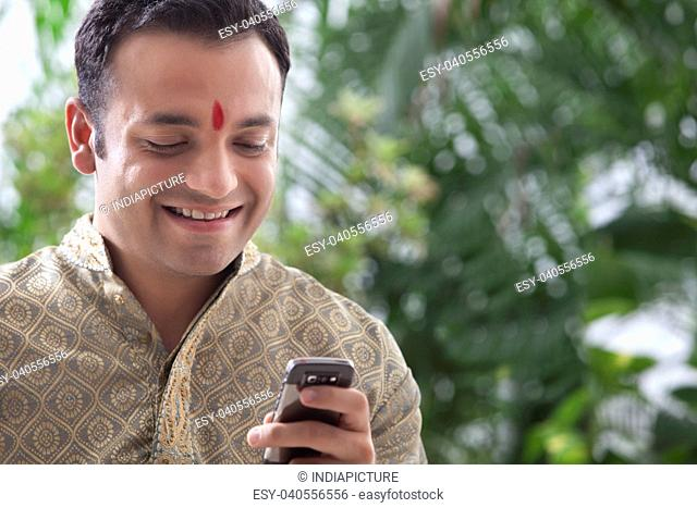 Man reading an sms on a mobile phone