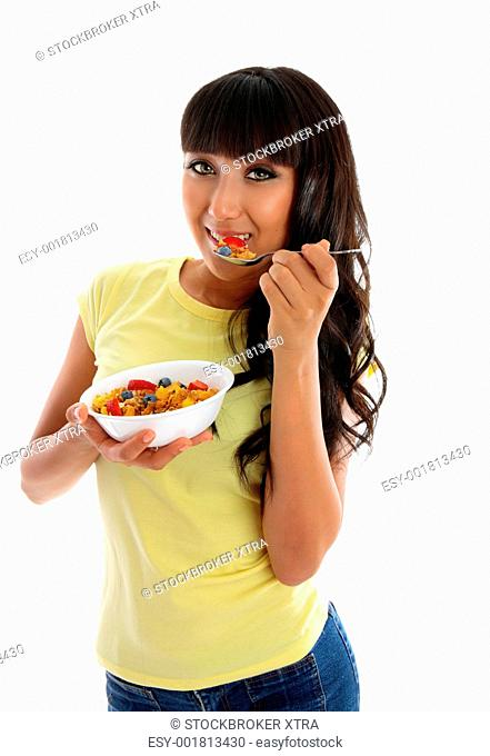 A young beautiful woman eating well and looking great