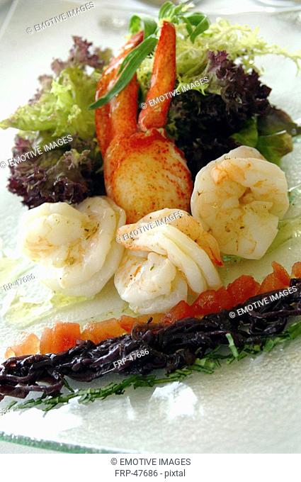 A dish of lobster, scampi and salad