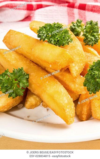 french fries with parley on a white plate